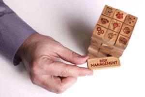 Hand pulling a risk management tile